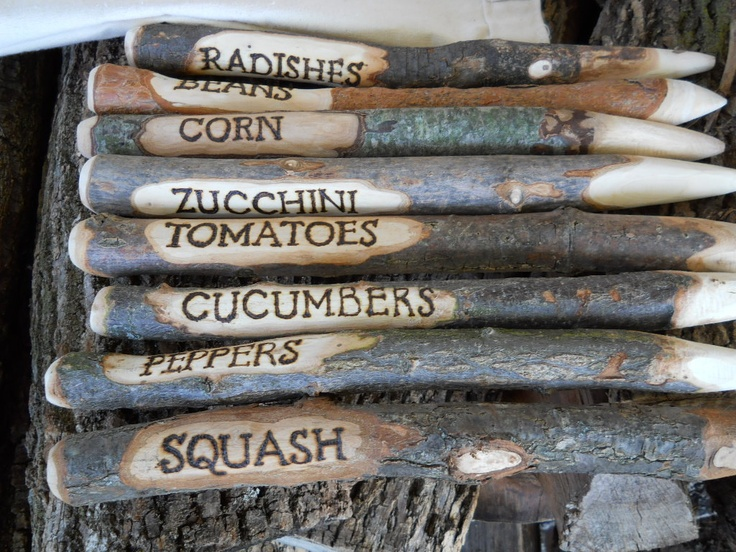 Carved and stamped sticks. Or you could simply write on them.