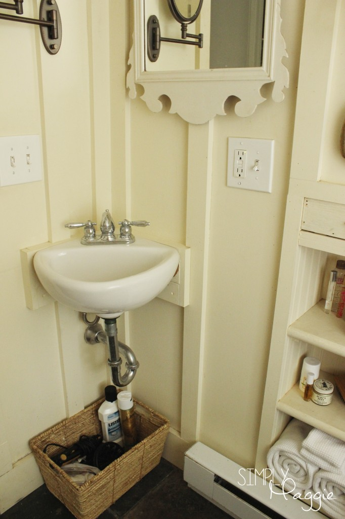 Small cottage bathroom corner sink and basket storage | SimplyMaggie.com